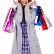 Stock Photo: Happy lady posing with shopping bags