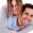 Young man giving piggyride to her girlfriend — Stock Photo #3745043