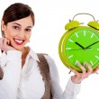 Lady holding alarm clock - Stock Photo