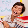 Smiling boy with school books - Stock Photo