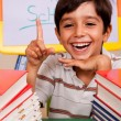 Smiling young student pointing up — Stock Photo