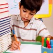 Young kid busy in drawing — Foto Stock