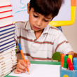 Young kid busy in drawing — Stock Photo