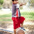 Smart kid posing with basketball — 图库照片
