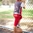 Rear view of young basketball player - Stock Photo