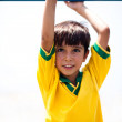 Young boy hanging on jungle gym — Stock Photo