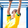 Smart kid playing on jungle gym — Stock Photo