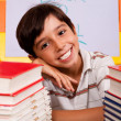 Young boy with stack of books — Stock Photo #3809493