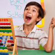 Boy with abacus screaming loudly - Stock Photo