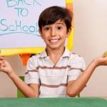 Cheerful school boy holding an apple — Stock Photo