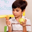 Young kid holding an apple - Stock Photo