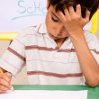 Stock Photo: Little boy has troubles with homework
