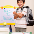 Happy student in his classroom — Foto de Stock