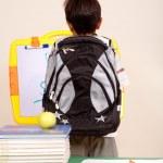 Rear view of a smart school kid — Stock Photo