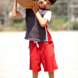 Boy with basketball on his shoulders — Stock Photo