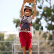 Young basketball player jumping high — Stock Photo