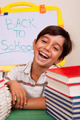 Smiling boy with school books — Stock Photo