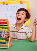 Boy with abacus screaming loudly — Stock Photo