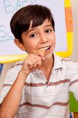 School boy enjoying his lunch meal — Stock Photo