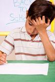 小男孩已做家庭作业的烦恼 — 图库照片