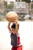 Cute young kid holding basketball — Stok fotoğraf