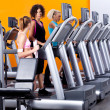 Lady instructor in gym — Stock Photo