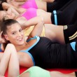 Stock Photo: Group of doing stretching exercise