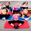 Women doing floor excercise — Stockfoto