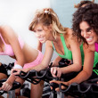 Stock Photo: Women at gym doing cardio exercises