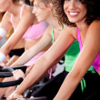 Stock Photo: Spinning on bicycles in a gym