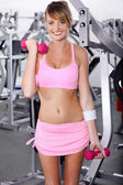 Portrait of strong woman lifting barbell — Stock Photo
