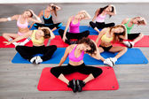 Women doing floor excercise — Stock Photo