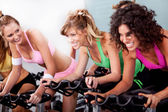 Women at the gym doing cardio exercises — Stock Photo