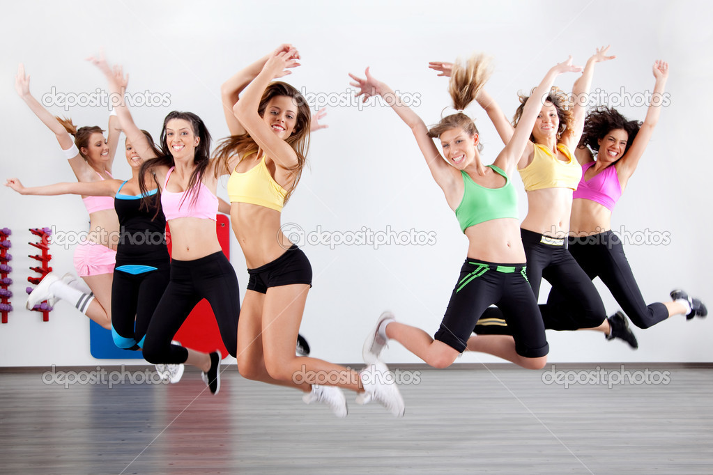 Group of ladies working out in aerobic class — Стоковая фотография #3900867
