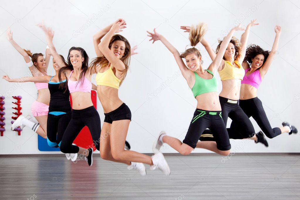 Group of ladies working out in aerobic class  Foto de Stock   #3900867