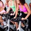 Spinning on bicycles in a gym — Stock Photo