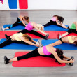Female stretching in an aerobics exercise class — Stock Photo #3947863