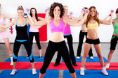 Women doing aerobics with dumbbell — Stock Photo