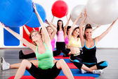 Doing stretching exercise with fitness balls — Stock Photo