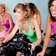 Female cycling in fitness club — Stock Photo