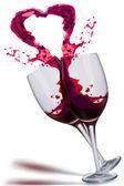 Wine splashing out in heart shape — Stock Photo
