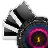 Camera lens with photographs — Stock Photo