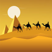 Tourists on camels in desert — Stock Photo