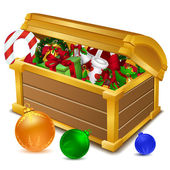 Treasure chest full of christmas goodies — Stock Photo