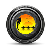 Camera lens with sea beach view — Stock Photo