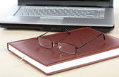 Organizer glasses and notebook — Stock Photo