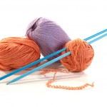 Balls of a yarn knitting spokes — Stock Photo