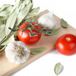 Tomatoes garlic and bay leaf branches — Stock Photo #3443375