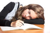 The girl-teenager looks in writing-book — Stock Photo