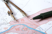 Topographic map of district with measuring instrument — Stock Photo